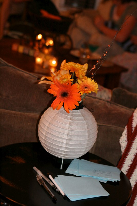 Flowers filled Japanese lanterns that were found around the room