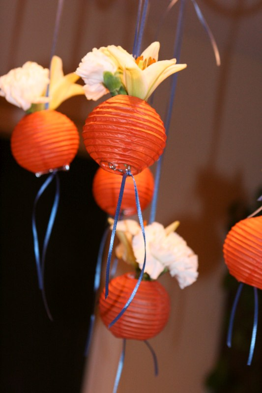 The flower filled lanterns hung from the ceiling as well over the table of hourdourves