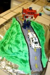 Kedrick's transformer cake with Optimus and Jazz
