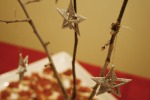 Trim your trees and save some twigs.  Place them in a vase and add some ornaments, silver glittered stars are classic and beautiful.